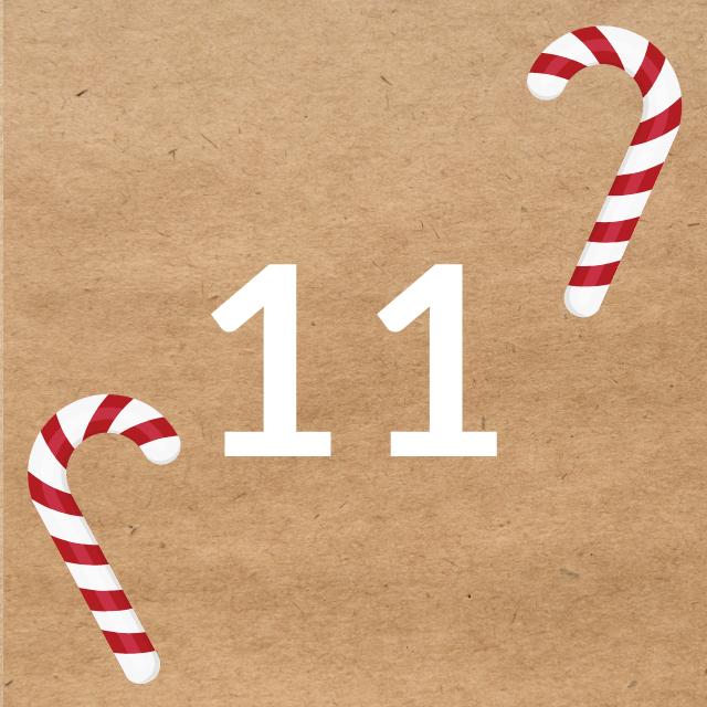 Zahl 11, auf braunen Untergrund mit Adventsdesign
